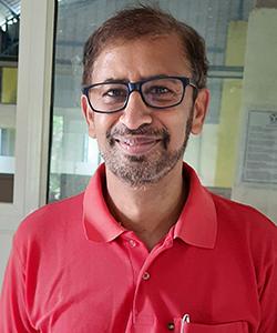 Dr. Arun Dixit